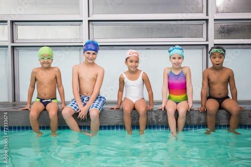Cute swimming class smiling at camera - 72333674