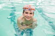Cute little boy in the swimming pool