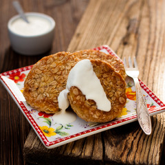 potato patties with oat flakes with sour cream