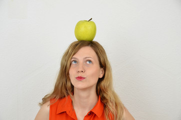 Young and sensual blonde girl with green apple isolated