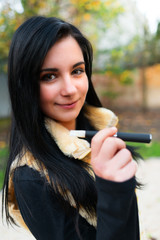 Woman smoking with electronic cigarette