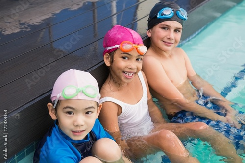 Cute swimming class in the pool