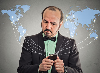 Business man holding smartphone connected browsing internet