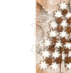 cinnamon stars and cookies cutters over white. christmas food