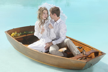 Happy Couple in Love on a Small Boat Outdoors