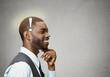 Headshot  happy man thinking found solution for problem