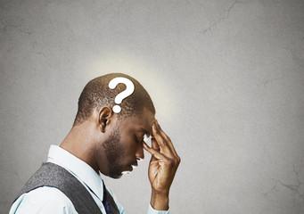Side profile headshot business man thinking solving problem