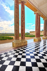 Grand Trianon courtyard and columns and garden in Palace of Vers