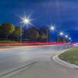 Road traffic and light trails at night