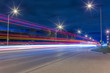 Road traffic and light trails at night - 72340475