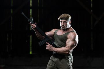 Confident Man Portrait With Machine Gun