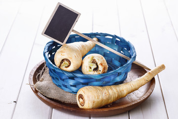 Group of parsnips in a blue woven basket