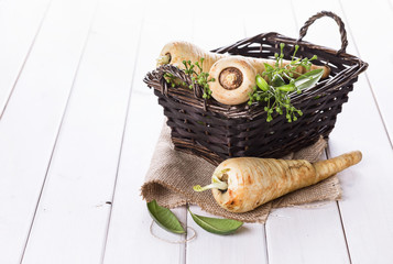 Group of parsnips in a woven basket