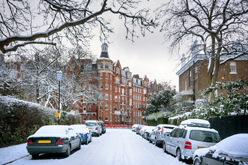 Snow covered street in Kensington, London.