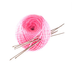 Wool with knitting needles close-up