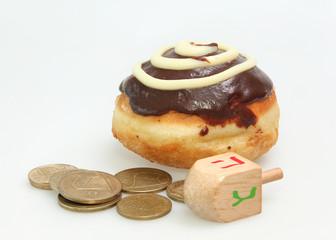 Hanukkah doughnut, coins and spinning top