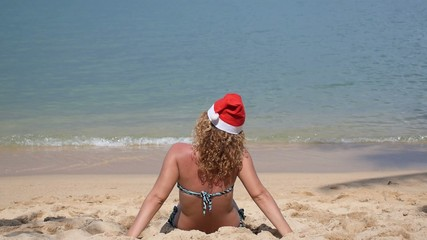 Christmas Vacation - Curly Woman in Santa Hat Dancing on the