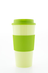 Green plastic coffee mug isolated on white background