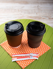 coffee in a paper cup and sugar