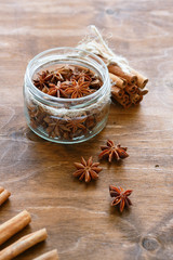 anise and cinnamon on wooden background