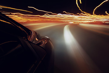 car driving through the city streets at night