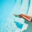Beautiful woman legs in swimming pool.