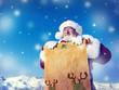 Santa Claus Holding Scroll Christmas Snow Concept