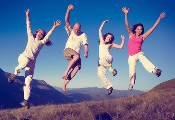 Group of People Jumping Happiness Outdoors