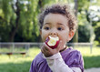 Child eating apple - 72347495