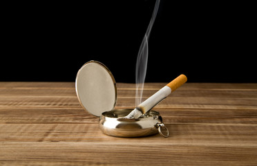 cigarette in an ash-tray