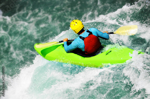 Fotobehang Extreme Sporten White water kayaking as extreme and fun sport