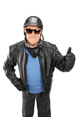 Vertical shot of mature biker giving a thumb up