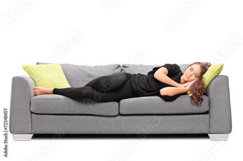 Young girl sleeping on a sofa - 72348457