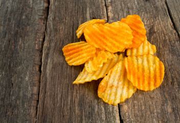 potato chips on wooden surface