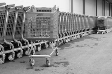 black-white baskets-carts on wheels for goods