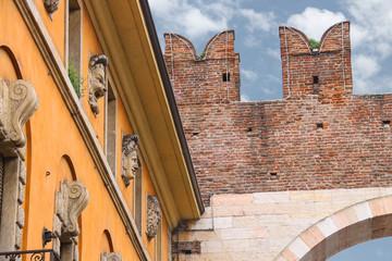 House near medieval city gate. Verona, Italy