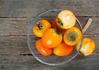 fresh persimmons in basket