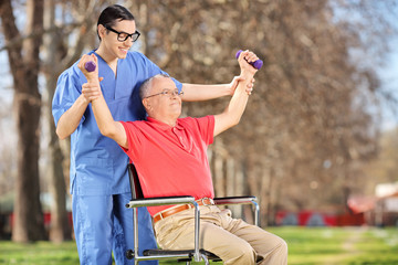Physiotherapist exercising with a patient in park