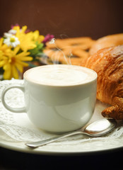 Continental breakfast with cappuccino and croissant