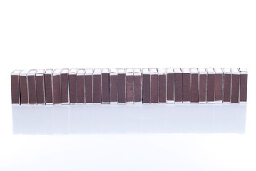 many Matchbox isolated on white background with reflection
