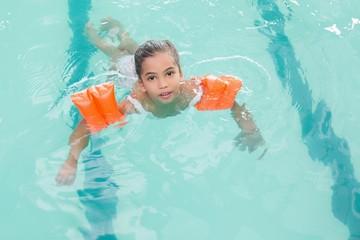 Cute little girl learning to swim