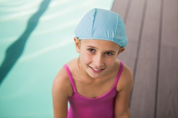 Cute little girl smiling poolside