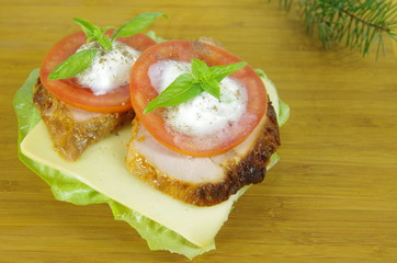 appetizing sandwich with meat and tomato on board