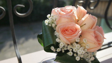 bridal bouquet of cream roses and green leaves