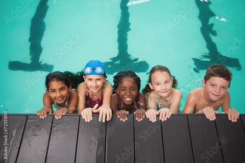 Cute swimming class smiling at camera - 72351898