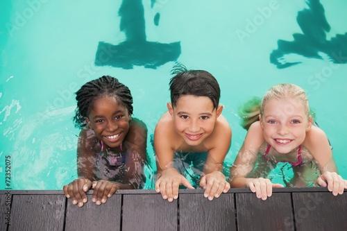 Leinwanddruck Bild Cute swimming class in pool with coach