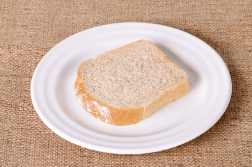 Sliced bread on sackcloth background