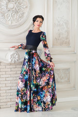 Woman in colored long dress