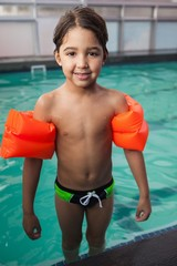 Little boy smiling at the pool
