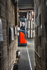 middle aged reach truck driver